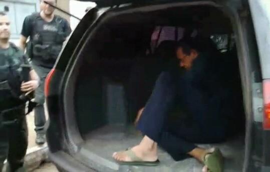Raimundo Lisboa sendo levado preso.